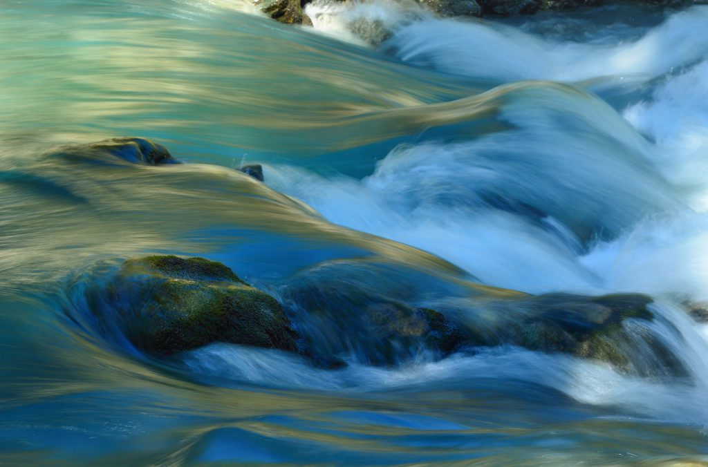 Turbulent water flow over rocks