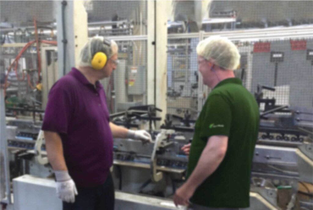 two workers in manufacturing